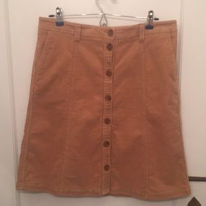 Tan corduroy skirt with buttons up the front
